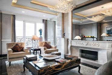 Luxury penthouse, exclusive suit at Baglioni Hotel, stylish living room.