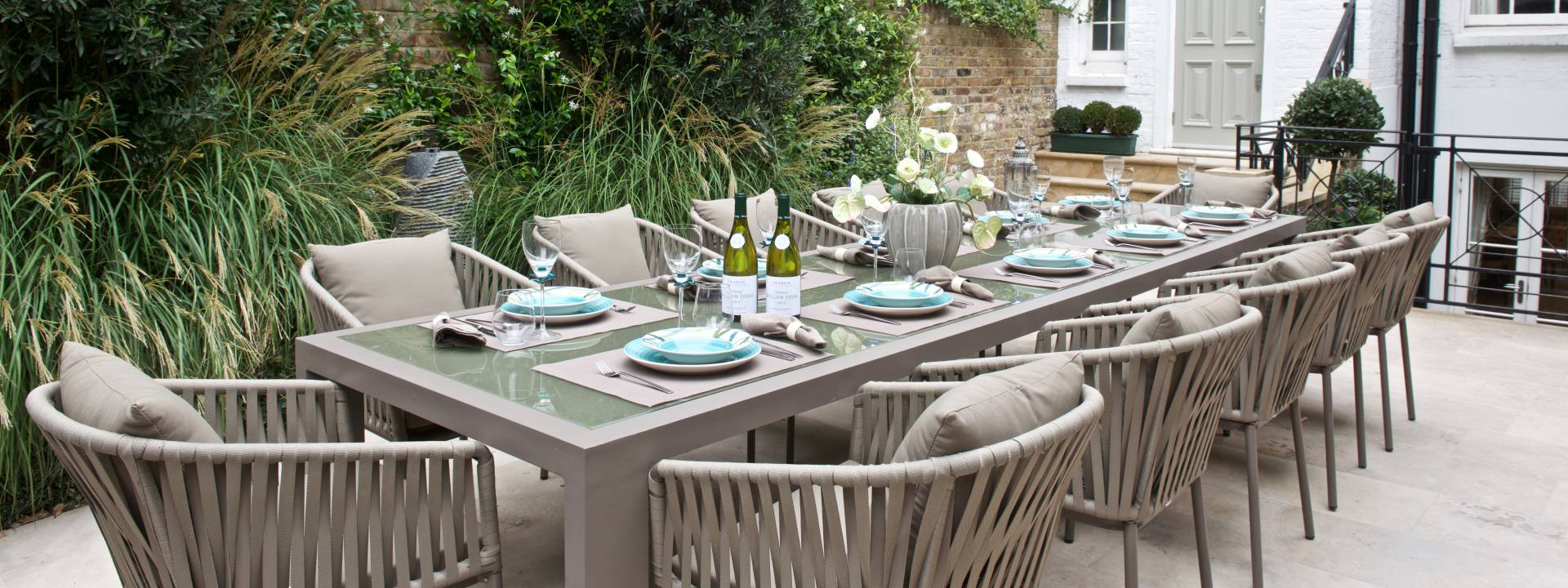 Exquisite Town-house.  Stunning dining table - garden. Taylor Interiors.