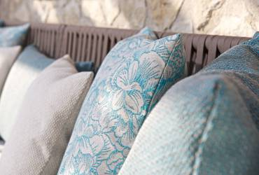 Contemporary Holiday villas. Luxury garden furniture. Turquoise cushions.